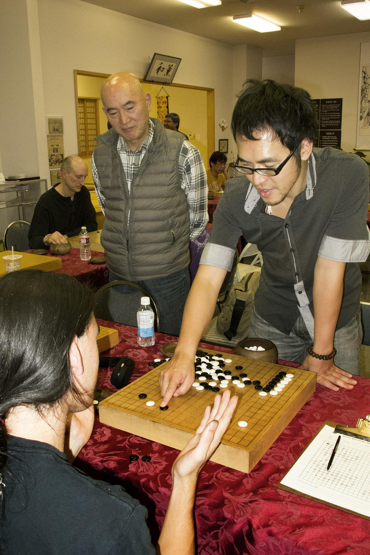 Kuma Sensei giving a lesson after a simul game