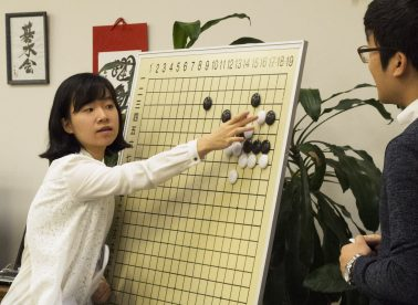 Visiting Professional Go Player Yoonyoung Kim at Teaching Board